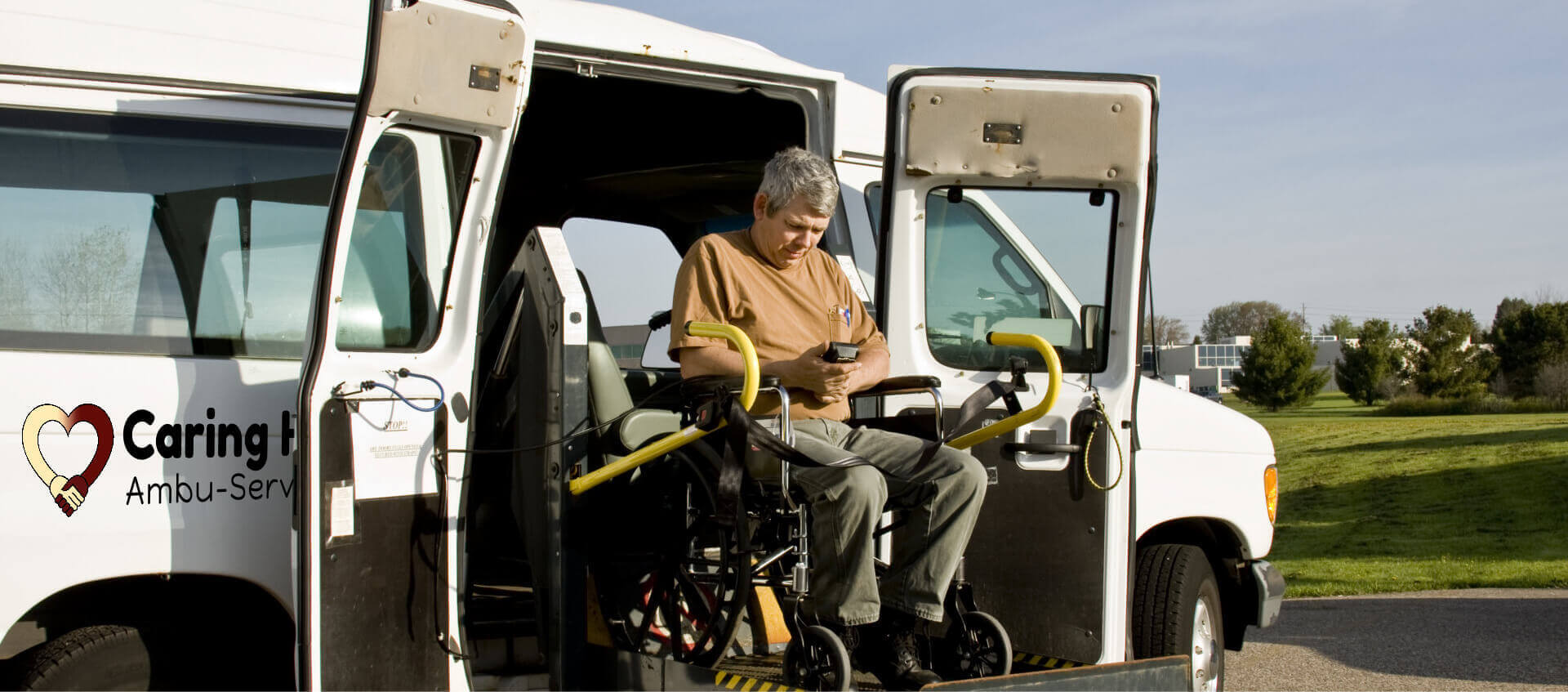 man on wheelchair exiting a van