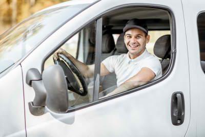 cheerful driver inside a car